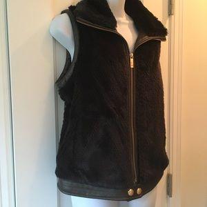 Unique plush fur & leather-like vest; fun lining!